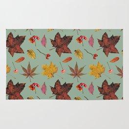 Autumn pattern on green background Rug