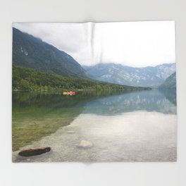 Kayaking on Lake Bohinj Throw Blanket