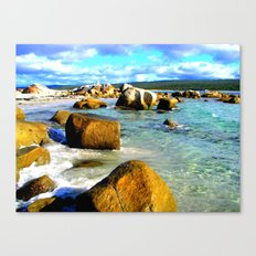 Rocks in the ocean on a sunny day Canvas Print