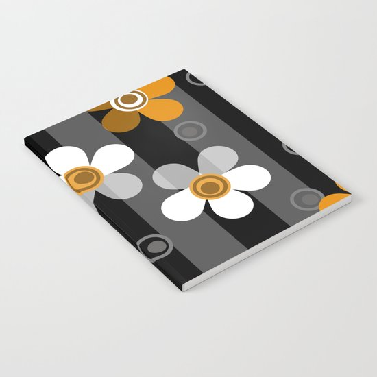 Black and yellow floral pattern on a striped background . Notebook
