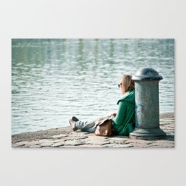 Reading at the pier Canvas Print