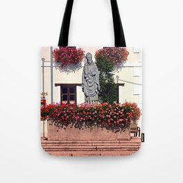 A saint and lots of flowers Tote Bag