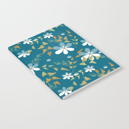 White flowers on a blue background . Notebook