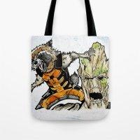 rocket raccoon Tote Bags featuring Rocket Raccoon and Groot by artbyteesa