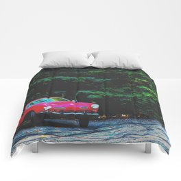 red classic car in the forest with green tree background Comforters