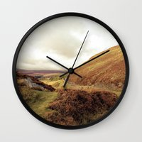 ruben ireland Wall Clocks featuring Ireland. by Ashley Jensen