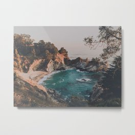 sunset on blue ocean cove with waterfall Metal Print