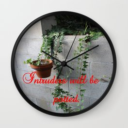 Intruders will be potted Wall Clock