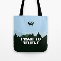 i want to believe Tote Bags featuring i want to believe. by dann matthews