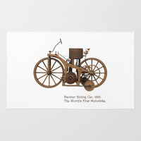 mercedes Area & Throw Rugs featuring Daimler Riding Car, 1885. The world's first motorbike. by Marijan Zubak