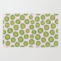 preppy Area & Throw Rugs featuring Candy is Dandy Ikat-Preppy colors by Groovity