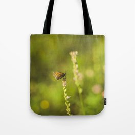 Butterfly on a wild flower Tote Bag