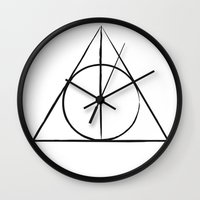 deathly hallows Wall Clocks featuring The Deathly Hallows by A. Design