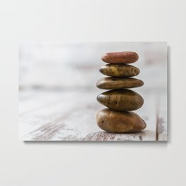 Pile of dark colored stones on white Metal Print