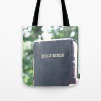 bible Tote Bags featuring Holy Bible w/ bokeh by Hannah Chapman