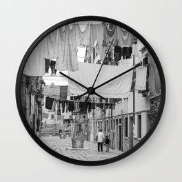 Kid and Grandma in street black white  Venice italy Wall Clock