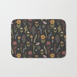 flat lay floral pattern on a dark background Bath Mat