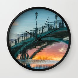 the reflection of the pedestrian bridge Wall Clock