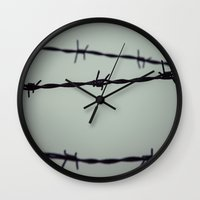 the wire Wall Clocks featuring Barbed Wire by Maria Heyens