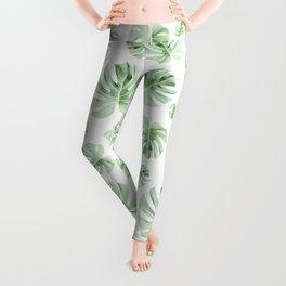 Tropical green leaves on white Leggings