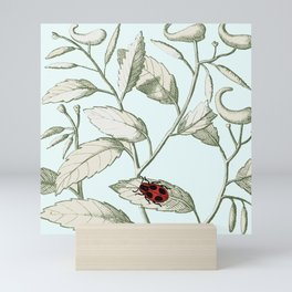 Noli me tangere- ladybird on leaf Mini Art Print