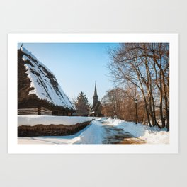 Heavy snow on a street in a traditional Romanian village Art Print