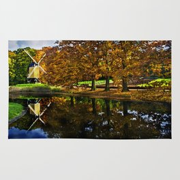 Autumn landscape with a windmill and pond in the Netherlands  Rug
