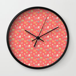 Colorful bunnies on salmon/pink Wall Clock