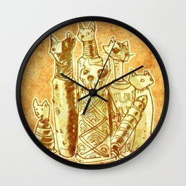 cat mummies with sand background Wall Clock