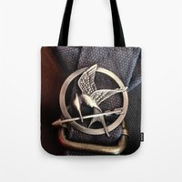 mockingjay Tote Bags featuring Mockingjay by AndyGD