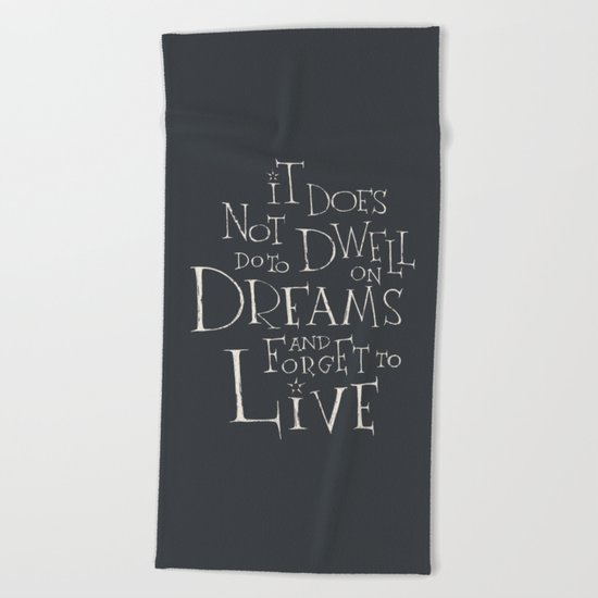 "Harry Potter - Albus Dumbledore quote ""It does not do to dwell on dreams"" Beach Towel"