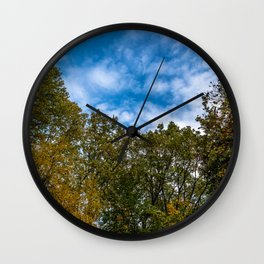 Trees and sky Wall Clock