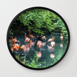 Pink flamingos in a pond Wall Clock