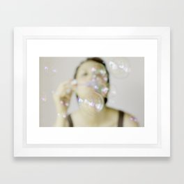 Blowing soap bubbles Framed Art Print