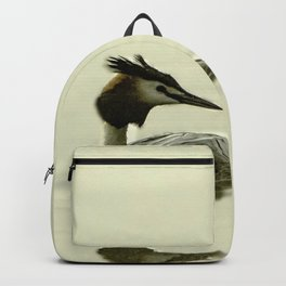 Photograph of a Grebe reflecting in the water Backpack