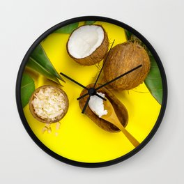 Coconut oil, tropical leaves and fresh coconuts, top view Wall Clock