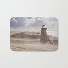 Sandstorm at the lighthouse Bath Mat
