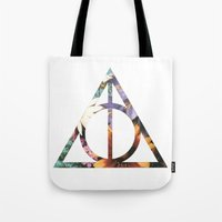 deathly hallows Tote Bags featuring Deathly Hallows by Romana Catalini