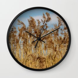 Lenz gently blowing the stalks Wall Clock