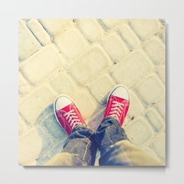 young man feet in red sneakers on cobbled road Metal Print