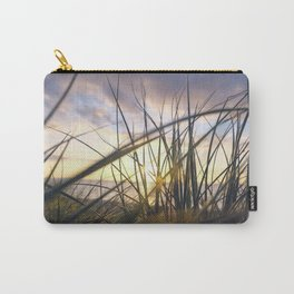 Sun light is coming through green grass in the sun set with sea in the behind and cloudy sky Carry-All Pouch