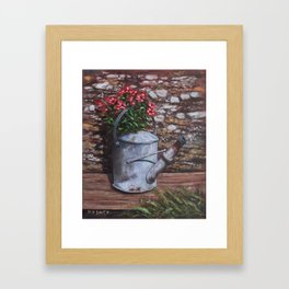 Old watering can with flowers by stone wall Framed Art Print