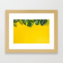 Tropical leaves on yellow background, space for text Framed Art Print