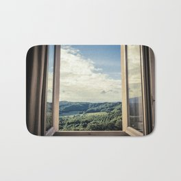 Panoramic view of the rolling hills of Chianti through a window in early morning Bath Mat