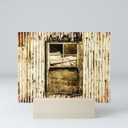 Window in a tin wall Mini Art Print