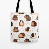 guinea pig Tote Bags featuring The Essential Guinea Pig by micklyn