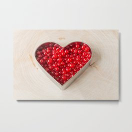 Currants in heart shaped cookie cutter on wood Metal Print