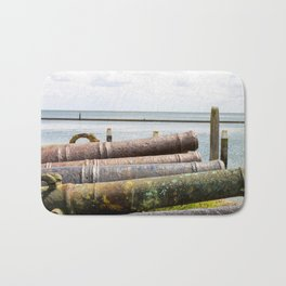 Old rusty cannons. Bath Mat