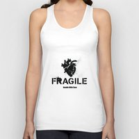 anatomical heart Tank Tops featuring Fragile Anatomical Heart by J ō v