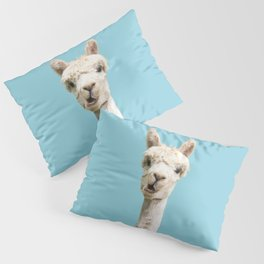 Cute white alpaca portrait on blue sky background Pillow Sham